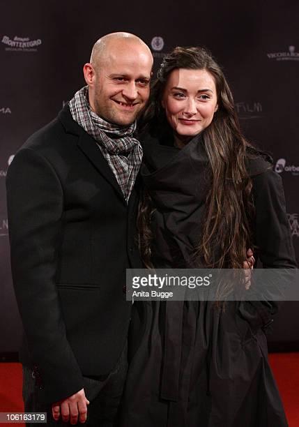 Actor Juergen Vogel and Michelle Gornick attend the 'Die kommenden Tage' film premiere at CineStar on October 27, 2010 in Berlin, Germany.