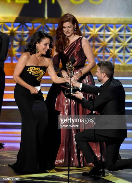 Actor Julia LouisDreyfus accepts Outstanding Lead Actress in a Comedy Series for 'Veep' from actor Debra Messing and TV personality Chris Hardwick...
