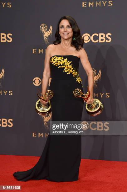 Actor Julia Louis-Dreyfus, winner of the award for Outstanding Comedy Actress for 'Veep,' poses in the press room during the 69th Annual Primetime...