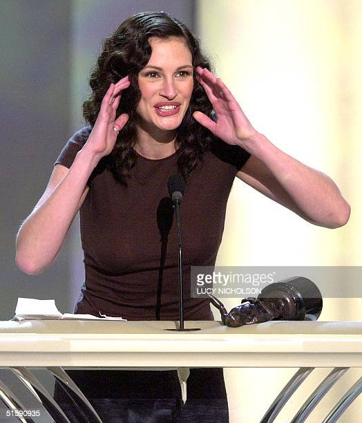 US actor Julia Roberts accepts her award for Outstanding Performance by a Female Actor in a Leading Role for Erin Brockovich at the 7th Annual Screen...
