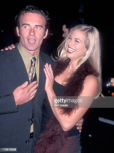 Actor Julian McMahon and actress Brooke Burns attend the 'Pleasantville' Westwood Premiere on October 19 1998 at the Mann National Theatre in...