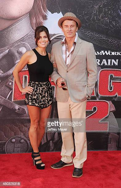 Actor Julian McMahon and model Kelly Paniagua arrive at the Los Angeles premiere of 'How To Train Your Dragon 2' at the Regency Village Theatre on...
