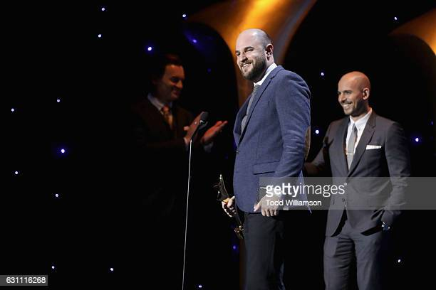 Actor Julian McMahon on stage with producers Jordan Horowitz and Fred Berger at The 6th AACTA International Awards on January 6 2017 in Los Angeles...