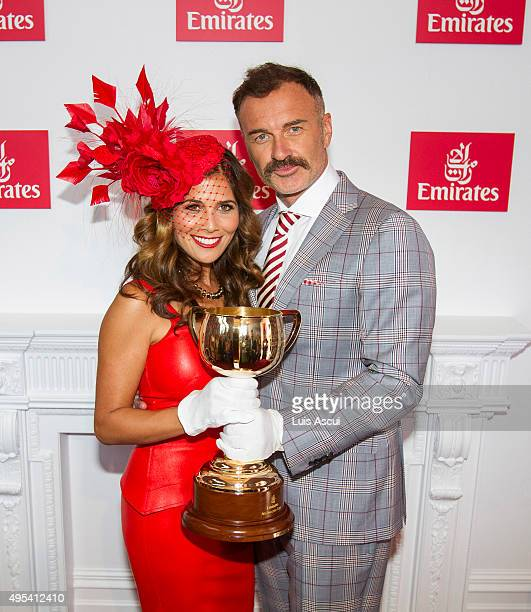 Actor Julian McMahon poses with wife Kelly McMahon at the Emirates Marquee on Melbourne Cup Day at Flemington Racecourse on November 3 2015 in...