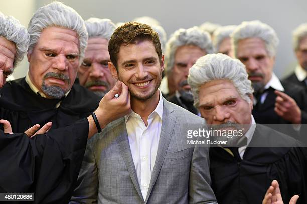"Actor Julian Morris of ""Hand of God"" poses with Ron Perlman impersonators at The Getty Images Portrait Studio powered by Samsung Galaxy At ComicCon..."