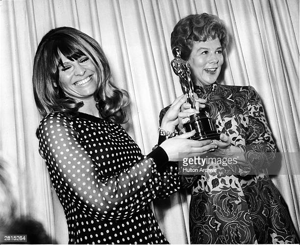 Actor Julie Christie smiles as she presents the Best Actor Oscar to Wendy Hiller, accepting for absent actor Paul Scofield for his role in the film,...