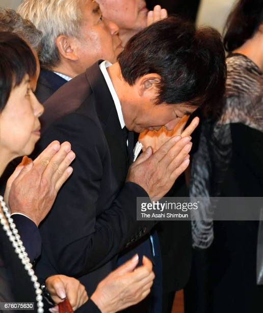 Actor Junichi Ishida offers a flower at an altar at the farewell meeting for late musician Hiroshi Kamayatsu on May 2, 2017 in Tokyo, Japan.