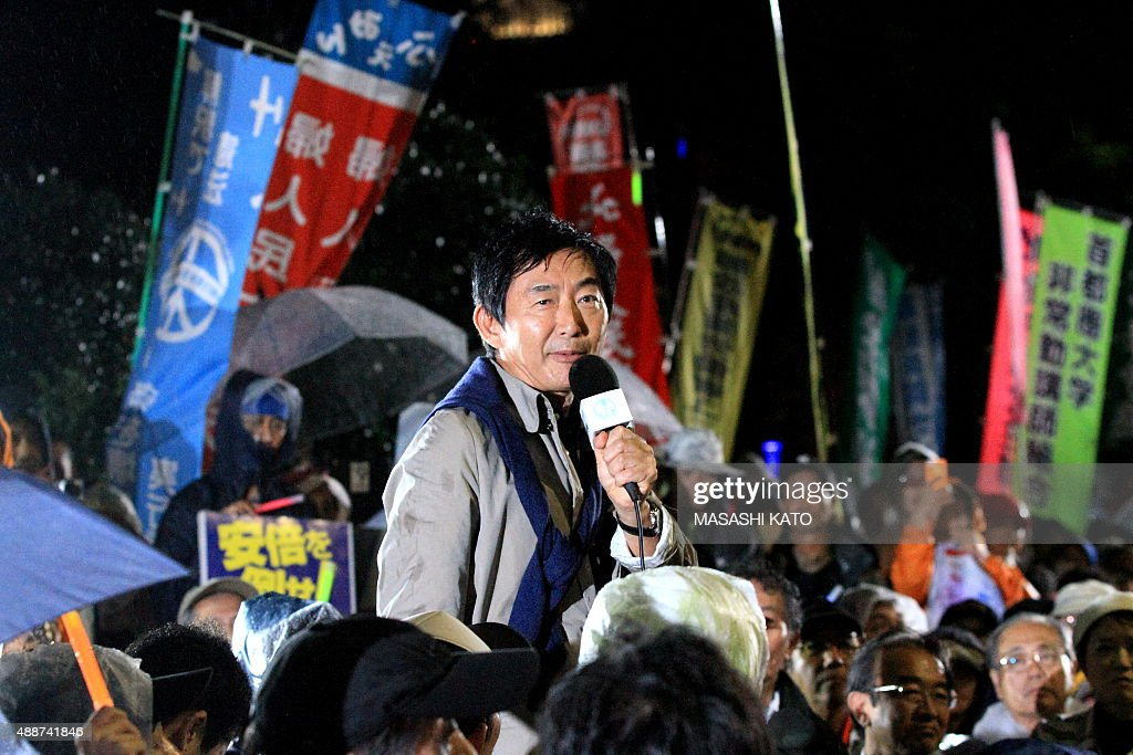 Actor Junichi Ishida speaks during a protest against the new Japan Security Bill on September 17, 2015 in Tokyo, Japan. Hundreds of people gathered to protest against the security bills to expand the roles of Japan Self Defense Force. The scheduled committee vote, which is the second to last vote before the law officially being passed, has been repeatedly delayed by the opposition party. The ruling coalition party lawmakers are aiming to pass the legislation before the end of week.