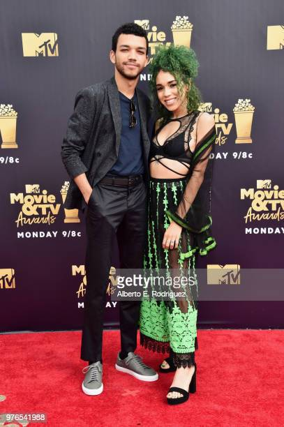 Actor Justice Smith and singer Cameo Adele attend the 2018 MTV Movie And TV Awards at Barker Hangar on June 16 2018 in Santa Monica California