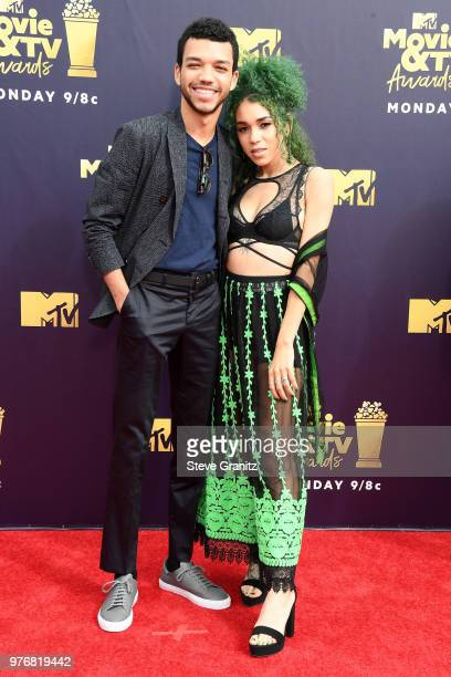 Actor Justice Smith and singer Cameo Adele attend the 2018 MTV Movie And TV Awards at Barker Hangar on June 16, 2018 in Santa Monica, California.
