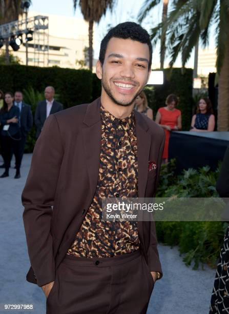 "Actor Justice Smith arrives at the premiere of Universal Pictures and Amblin Entertainment's ""Jurassic World: Fallen Kingdom"" at the Walt Disney..."