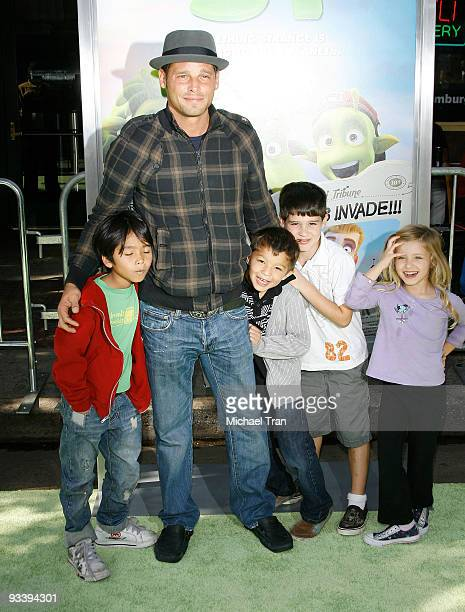 Actor Justin Chambers and family arrive to the Los Angeles premiere of Planet 51 held at the Mann Village Theatre on November 14 2009 in Westwood...