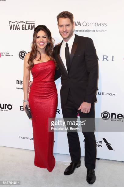 Actor Justin Hartley and Chrishell Stause attend the 25th Annual Elton John AIDS Foundation's Academy Awards Viewing Party at The City of West...