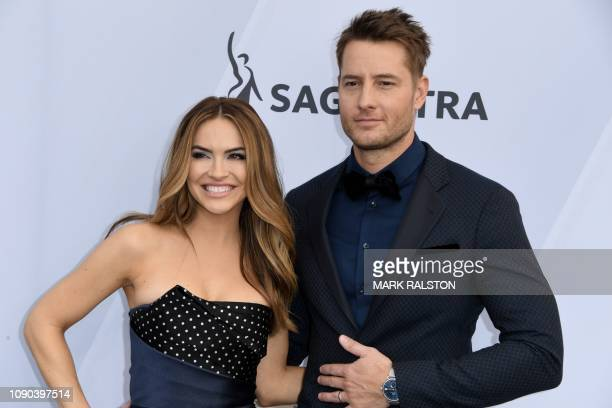 Actor Justin Hartley and his wife actress Chrishell Hartley arrive for the 25th Annual Screen Actors Guild Awards at the Shrine Auditorium in Los...