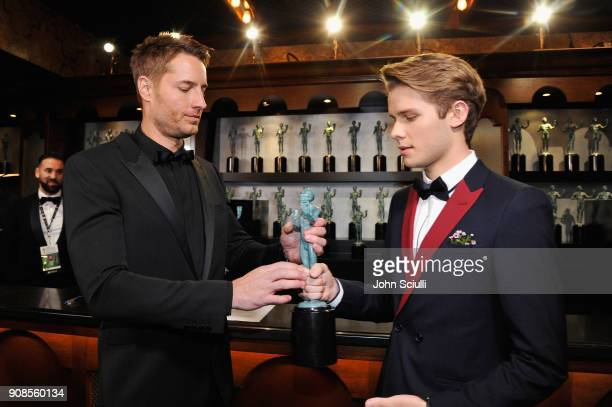 Actor Justin Hartley and Logan Shroyer in the trophy room at the 24th Annual Screen Actors Guild Awards at The Shrine Auditorium on January 21 2018...