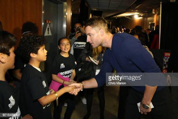 Actor Justin Hartley shakes hands with a young fan during the NBA AllStar Game as a part of 2018 NBA AllStar Weekend at STAPLES Center on February 18...