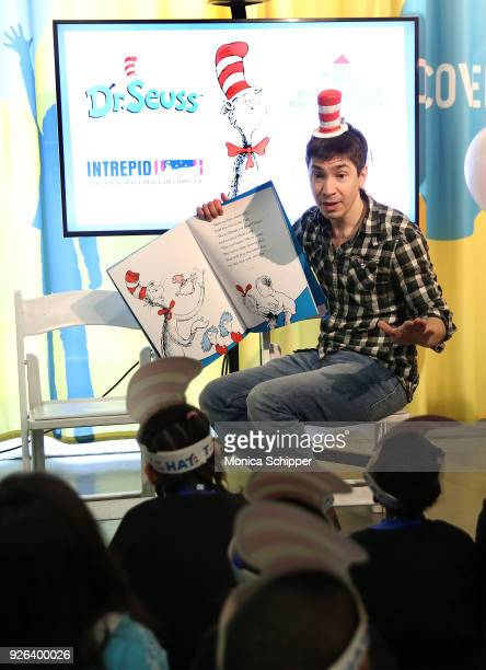 Actor Justin Long reads to elementary school children from the Garden of Dreams Foundation during Read Across America Day Celebrates Dr Seuss'...