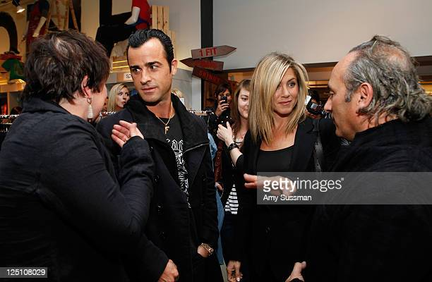Actor Justin Theroux actress Jennifer Aniston and cofounder of Hoyle Jackson Geoffrey Roiz attend Bloomingdale's 59th St Launches Hoyle Jackson on...