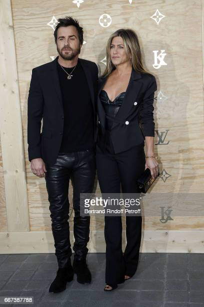 Actor Justin Theroux and Actress Jennifer Aniston attend the LVxKOONS exhibition at Musee du Louvre on April 11 2017 in Paris France