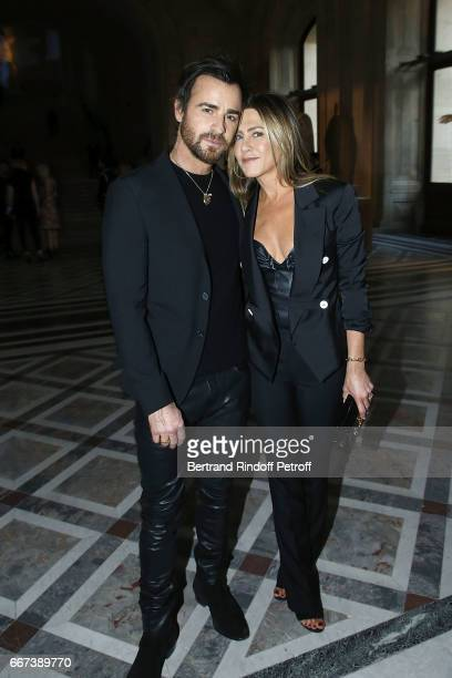 Actor Justin Theroux and Actress Jennifer Aniston attend the 'LVxKOONS' exhibition at Musee du Louvre on April 11 2017 in Paris France