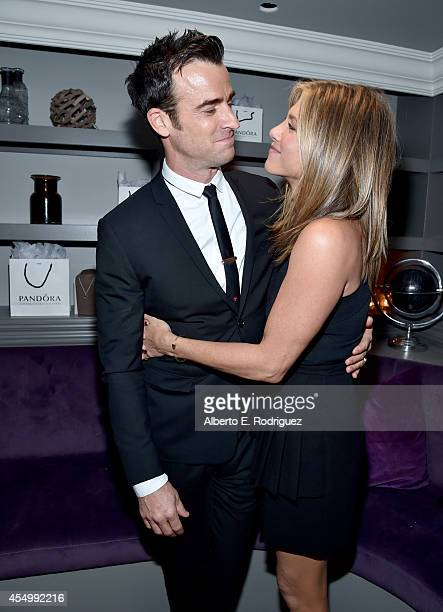 Actor Justin Theroux and actress/executive producer Jennifer Aniston attend the Cake cocktail reception presented by PANDORA Jewelry at West Bar on...