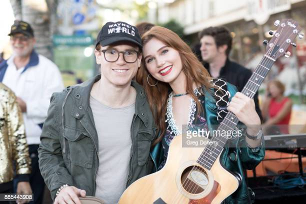 Actor Justin Tinucci and Actress singersongwriter and model Serena Laurel attend The Salvation Army Celebrity Kettle Kickoff Red Kettle Hollywood at...