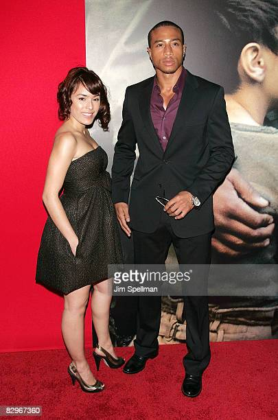 Actor Kalon Jackson with guest attends the premiere of Miracle at St Anna at Ziegfeld Theatre on September 22 2008 in New York City