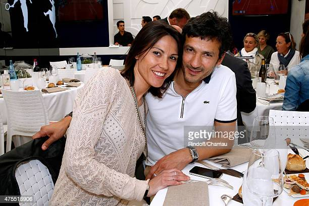 Actor Kamel Belghazi and his companion attend the 2015 Roland Garros French Tennis Open Day Nine on June 1 2015 in Paris France