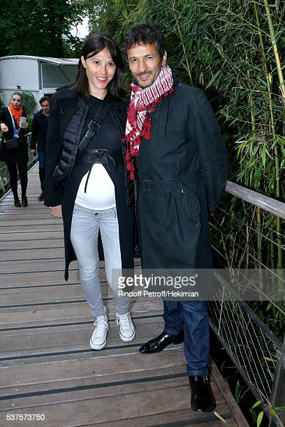 Actor Kamel Belghazi and his wife Marine Thierry attend Day Twelve of the 2016 French Tennis Open at Roland Garros on June 2 2016 in Paris France