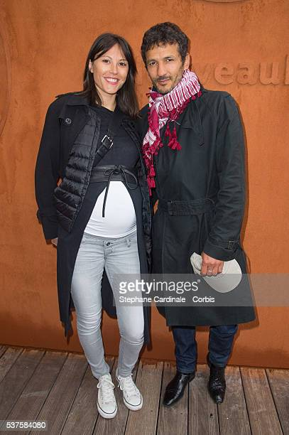 Actor Kamel Belghazi and his wife Marine Thierry attend day twelve of the 2016 French Open at Roland Garros on June 2 2016 in Paris France