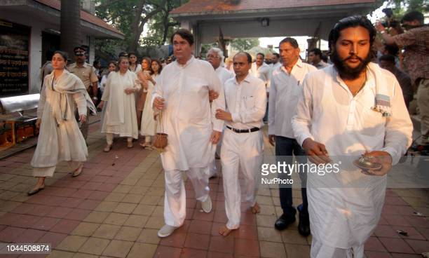 Actor Kareena Kapoor and her father Randhir Kapoor during the funeral of late Krishna Raj Kapoor who passed away of cardiac arrest in Mumbai on...