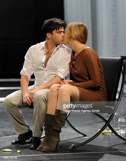Actor Karim Cherif performs together with Anne Haug at the 'Who's Afraid of Virginia Woolf' photo rehearsal at the 'Theater am Kurfuerstendamm' on...