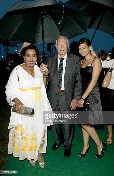 Actor Karl Heinz Boehm and wife Almaz and daughter Aida attend the Save The World Awards at the nuclear power station Zwentendorf on July 24 2009 in...