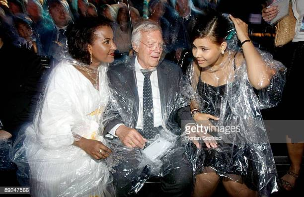 Actor Karl Heinz Boehm his wife Almaz and daughter Aida attend the 'Save The World Awards' at the nuclear power station Zwentendorf on July 24 2009...