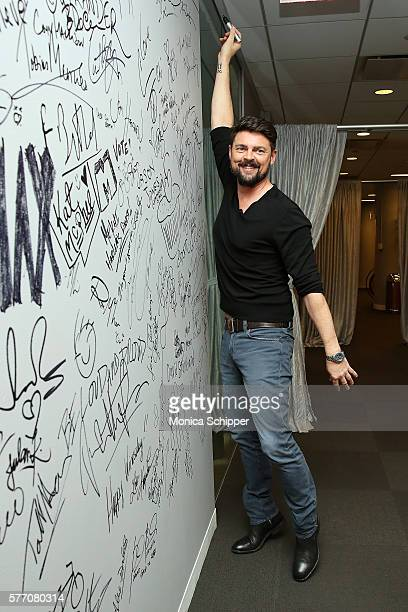 Actor Karl Urban signs the wall when he visits for AOL Build Speaker Series Karl Urban 'Star Trek Beyond' and 'Pete's Dragon' at AOL HQ on July 18...