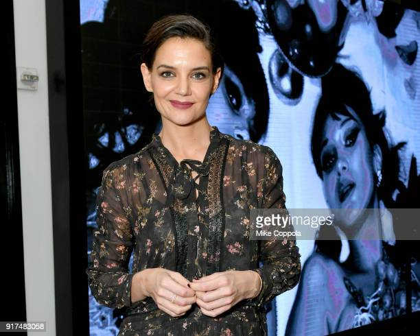 Actor Katie Holmes poses for a photo with lobby signage during IMG NYFW The Shows at Spring Studios on February 12 2018 in New York City