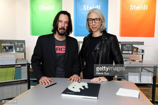 Actor Keanu Reeves and Artist Alexandra Grant are seen posing by their book 'Ode to happiness' during 'Paris Photo' at le Grand Palais on November 10...