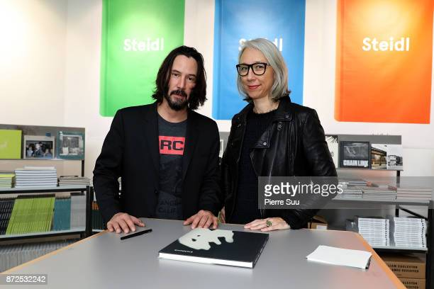 Actor Keanu Reeves and Artist Alexandra Grant are seen posing by their book Ode to happiness during Paris Photo at le Grand Palais on November 10...