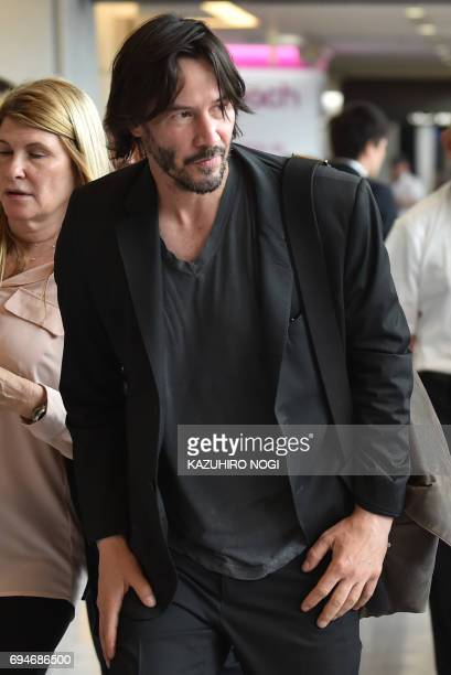 US actor Keanu Reeves arrives at Narita airport Chiba prefecture outside Tokyo on June 11 2017 Reeves is in Japan to promote his new film John Wick...