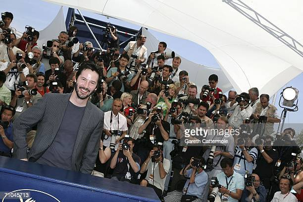 Actor Keanu Reeves attends a photocall promoting the film 'A Scanner Darkly' at the Palais des Festivals during the 59th International Cannes Film...