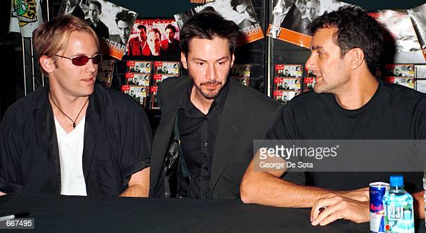 Actor Keanu Reeves, center, poses for photographers, July 11 with fellow band members of Dogstar, vocalist/guitarist Bret Domrose ,left, and drummer...