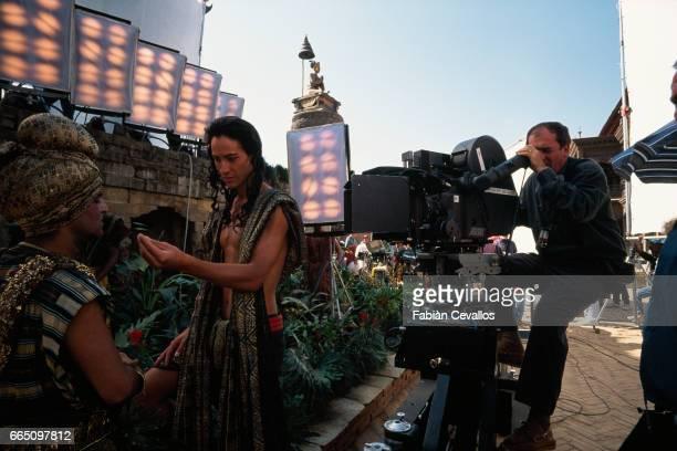 Actor Keanu Reeves filmed by Italian director Bernardo Bertolucci on the set of Bertolucci's film Little Buddha