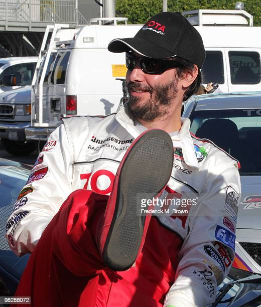 Actor Keanu Reeves kicks up his foot during the press practice day for the Toyota Pro/Celebrity Race on April 6 2010 in Long Beach California
