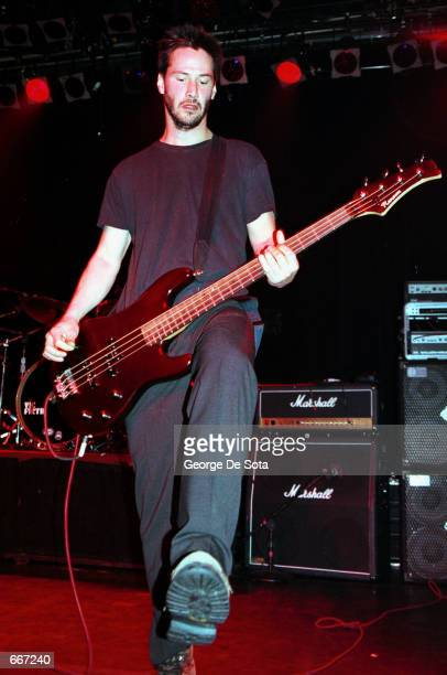 """Actor Keanu Reeves performs July 7, 2000 with his band """"Dogstar"""" at Irving Plaza in New York City."""