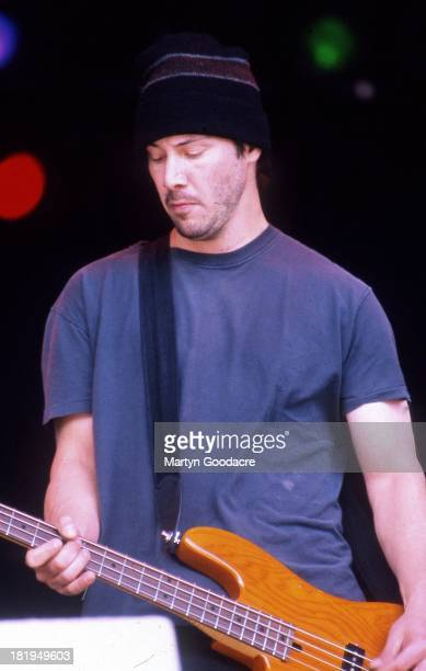 Actor Keanu Reeves performs on stage with his band Dogstar, Glastonbury, 1994.