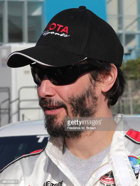 Actor Keanu Reeves poses for photographers during the press practice day for the Toyota Pro/Celebrity Race on April 6 2010 in Long Beach California