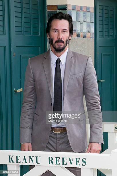 Actor Keanu Reeves poses next to the beach closet dedicated to him during a photocall on September 4, 2015 in Deauville, France.
