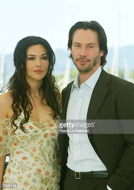 Actor Keanu Reeves poses with actress Monica Bellucci during a photocall for the film Matrix Reloaded at the Palais des Festivals during the 56th...