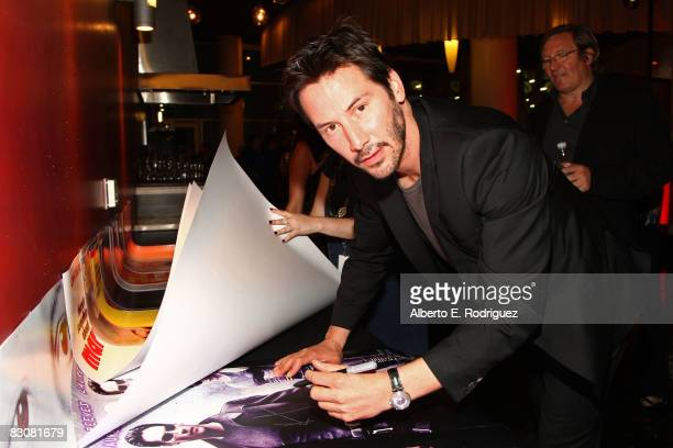 Actor Keanu Reeves signs an autograph in the Target Red Room during AFI's Night At The Movies presented by Target held at ArcLight Cinemas on October...