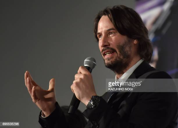 US actor Keanu Reeves speaks to the audience during the Japan Premier to promote his latest movie 'John Wick Chapter 2' in Tokyo on June 13 2017 The...